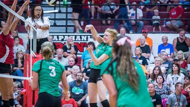 Yorktown's Tegan Seyring hits against Wapahani during their game at Wapahani High School Tuesday, Aug. 30, 2016.