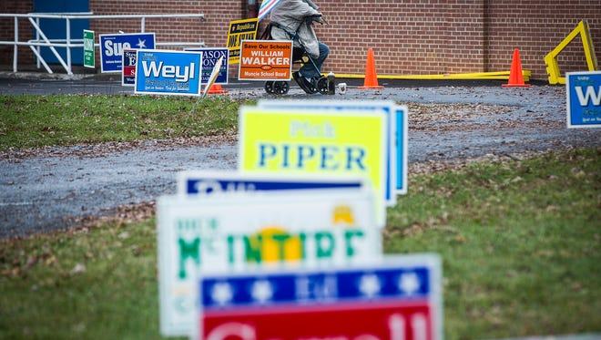 Virginia Graft sits outside of the Boys and Girls Club voting site in Precinct 19 to bolster support for school board candidate Bev Kelley Tuesday.