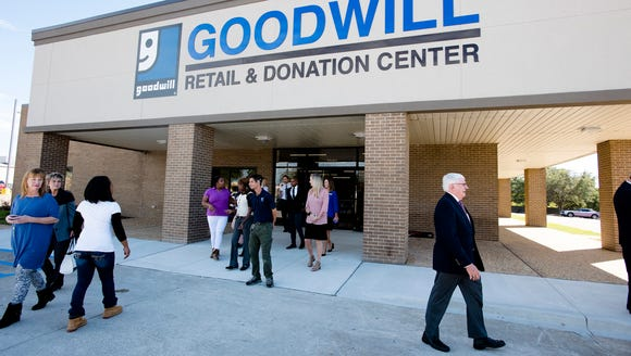 People walk outside during the opening of the Goodwill