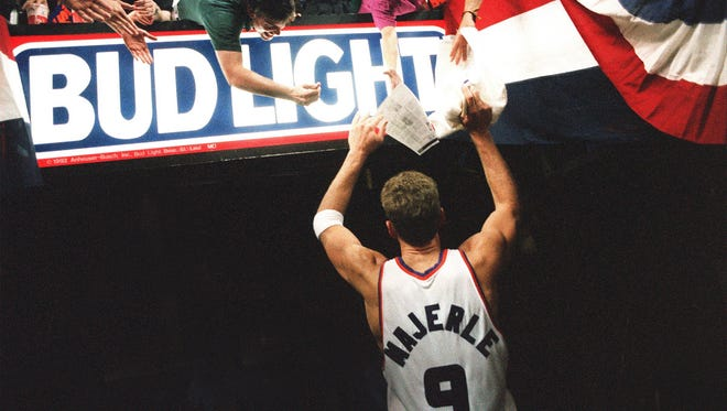 Dan Majerle is greeted by fans after Game 5 of the 1993 Western Conference Finals.