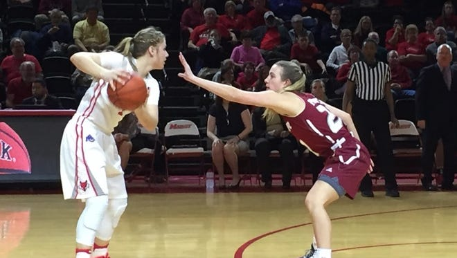 Claire Oberdorf, right, looks for an open teammate in the Marist College women's basketball team's game against Rider on Thursday.