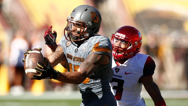 Arizona State wide receiver Devin Lucien makes a 57-yard catch past Arizona cornerback Cam Denson during the 89th Territorial Cup on Nov. 21, 2015, at Sun Devil Stadium in Tempe.
