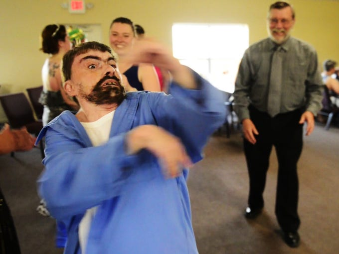 Freddie Bice, 42, of Port Clinton spins in circles