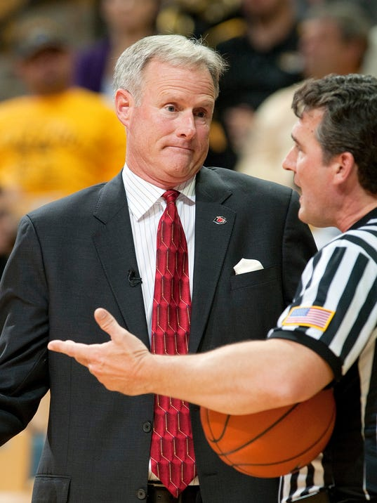 FILE - In this Nov. 1, 2013, file photo, Central Missouri head coach Kim Anderson, left, argues a call with the referee during the second half of an NCAA college basketball exhibition game against Missouri in Columbia, Mo. Missouri announced Monday, April 28, 2014, that it has hired Anderson, a former star player and longtime aide to Norm Stewart, as its men's basketball coach. (AP Photo/L.G. Patterson, File)