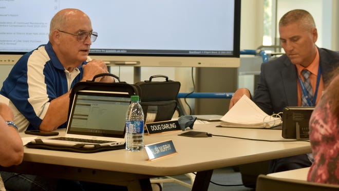 Leavenworth Board of Education President Doug Darling, left, prepares to start a school board meeting Monday. The meeting marked the first time board members had gathered in person in about three months. Also pictured is Superintendent Mike Roth.