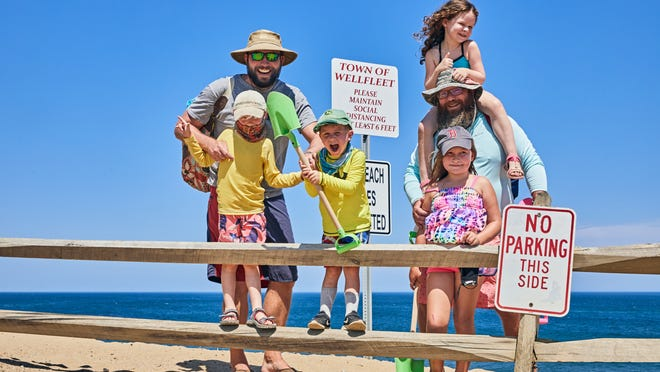 Cape Cod families, from left, the Mulletts (Joe, Everet and Milo) and the Mruks (Brendan, Kiva and Nami) set off to Lecount Hollow Beach to enjoy the ocean in Wellfleet.