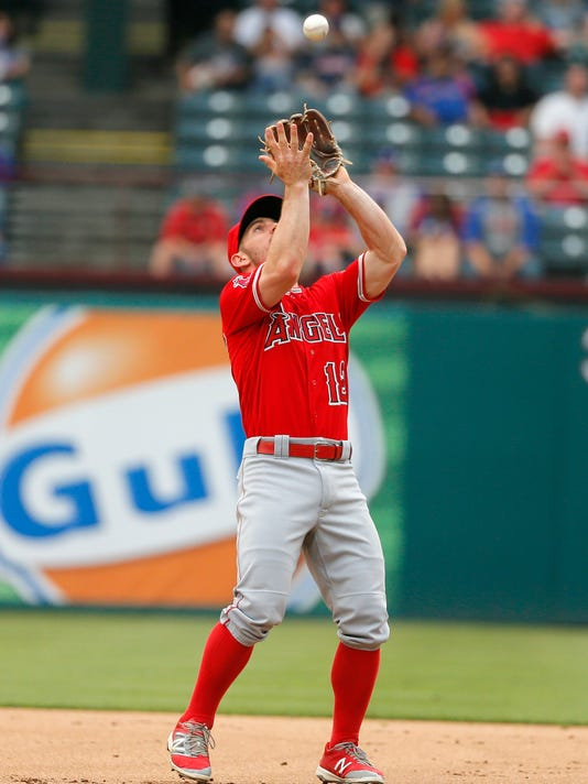 Los Angeles Angels second baseman Johnny Giavotella catches a pop-out by Texas Rangers' Ian Desmond during the second inning of a baseball game Friday, April 29, 2016, in Arlington, Texas. (AP Photo/Tony Gutierrez)