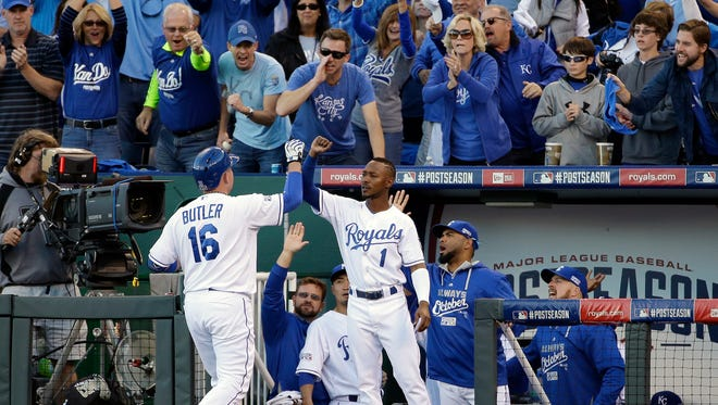Kansas City Royals designated hitter Billy Butler (16) is congratulated by Jarrod Dyson (1) after hitting a double during the eighth inning of Game 4 of the American League baseball championship series against the Baltimore Orioles Wednesday, Oct. 15, 2014, in Kansas City, Mo. (AP Photo/Matt Slocum )