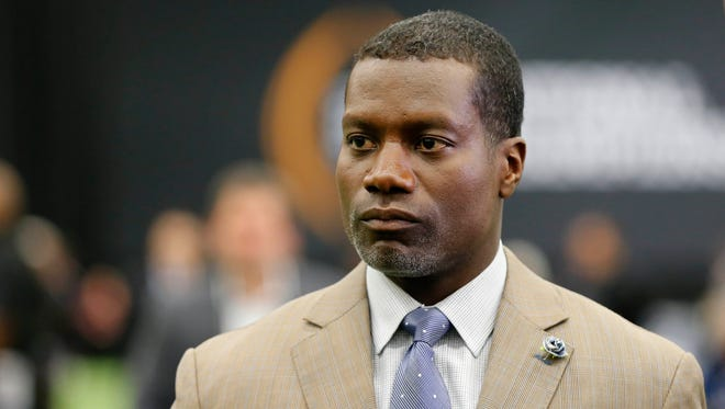 ESPN analyst Joey Galloway looks on during media day at the Dallas Convention Center.