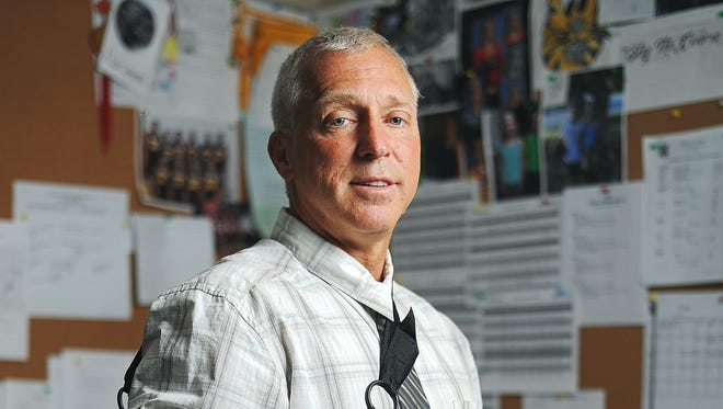 Kevin Lein, principal of Harrisburg High School, poses for a portrait Friday, Oct. 2, 2015, in his office at Harrisburg High School in Harrisburg, S.D., just days after he was shot. Lein was shot in the arm Wednesday morning in his office. Mason T. Buhl, a 16-year-old student who allegedly shot Lein, faces charges of attempted murder and commission of a felony with a firearm, according to Lincoln County StateÕs Attorney Tom Wollman.