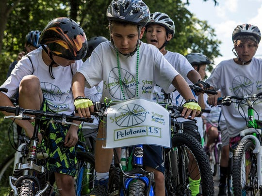 Photo from the 2nd annual SpokesKIDS ride. SpokesKIDS, a youth-driven fundraising event to fight cancer, is going on it's fourth year and has raised over $30,000 for cancer research.