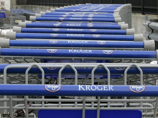 Shopping carts are lined up outside a Kroger Co. supermarket