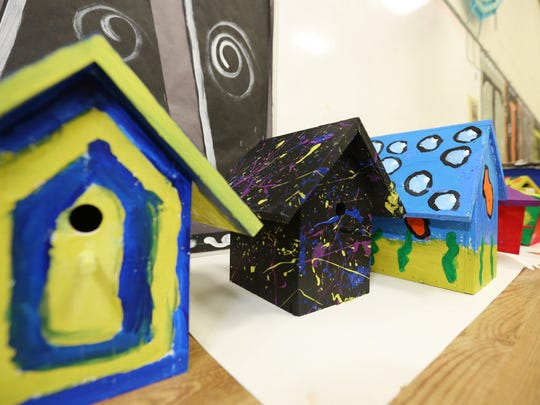 A line of birdhouses Stangel Elementary School sixth-graders