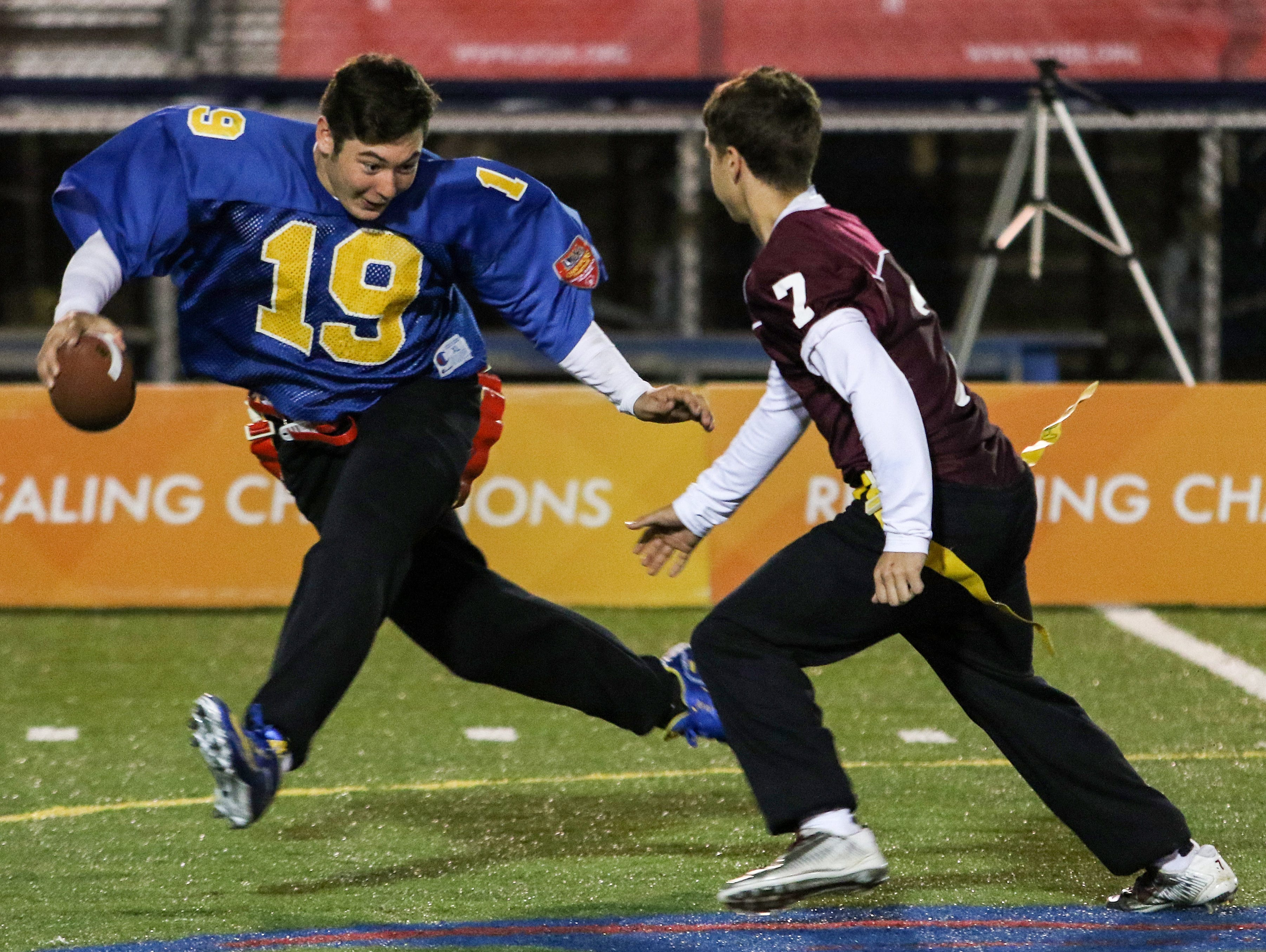 Caesar Rodney Unified Football partner Jared Wagnoffer tries to shake the chase of Concord athlete Luis Echevarria.