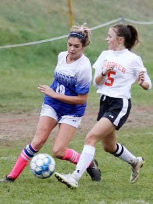 Gardner senior Kayla Keenan (5) was praised by GHS girls' varsity soccer coach Pete Gamache for her willingness to play any position on the field during her five seasons with the Wildcats.