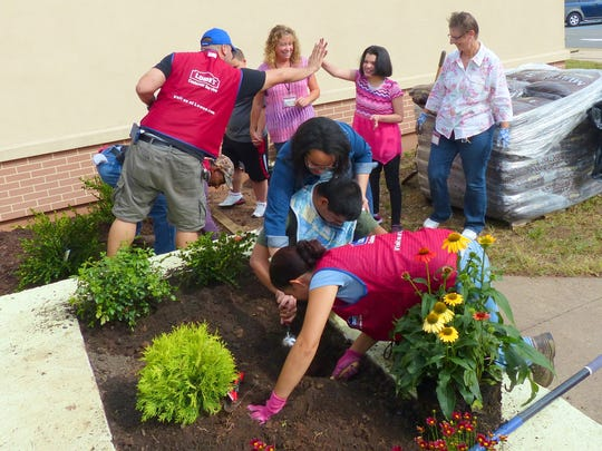 Many PRDS students had a chance to work with Lowe's volunteers, digging up soil and planting shrubs and flowers.