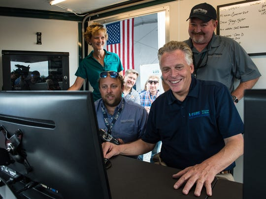 Virginia Governor Terry McAuliffe operates a drone from inside a mobile control center at Wallops Flight Facility on Friday, Sept. 22, 2017.