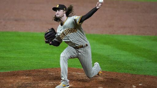San Diego Padres relief pitcher Matt Strahm works against the Colorado Rockies in the sixth inning on Friday at Coors Field in Denver. San Diego won 10-4.