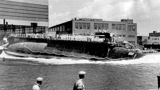 FILE - In this July 9, 1960, file photo, the U.S. Navy nuclear powered attack submarine USS Thresher is launched bow-first at the Portsmouth Navy Yard in Kittery, Maine. The Navy is releasing documents from the investigation into the deadliest submarine disaster in U.S. history. A judge ordered the release of the documents that pertain to the sinking of the USS Thresher 57 years ago, and the first batch was made public on Wednesday, Sept. 23, 2020.