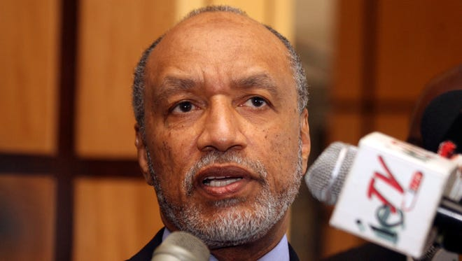 FILE - In this May 10, 2011 file picture of Mohamed bin Hammam, chief of the Asian Football Confederation, as he talks to local media in Port of Spain, Trinidad & Tobago.