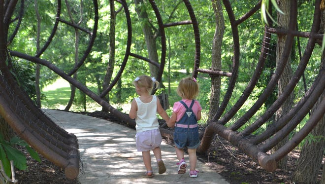 Two adventurers explore the Highfield Discovery Garden at Glenwood Gardens of Great Parks.