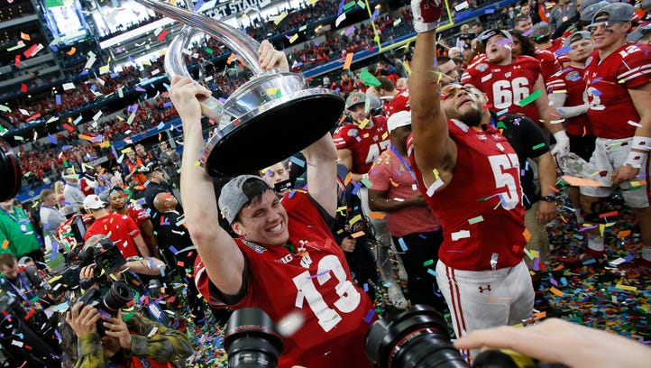 Wisconsin players celebrate after defeating Western Michigan in the 2017 Cotton Bowl.