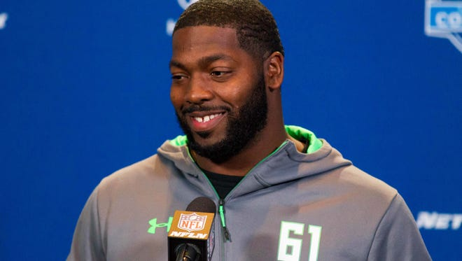 Ohio State defensive lineman Adolphus Washington speaks to the media during the 2016 NFL Scouting Combine at Lucas Oil Stadium.