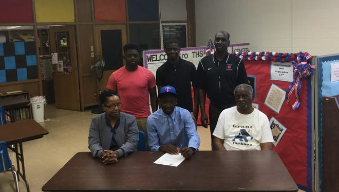 Grant Jackson signs with Tougaloo College.