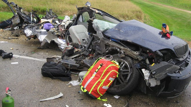 The remains of a car involved in an Oct. 7 head-on crash in Washington County are strewn about the roadway. One of the drivers involved was a 29-year-old Oconomowoc man.