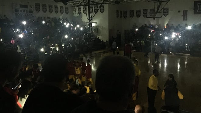 The lights went out at Douglass with less than a minute remaining in the third quarter of a Class A sectional on Monday.