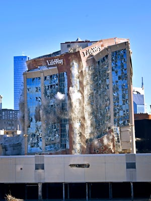 Rubble and dust fly as the LifeWay building is implodedSaturday Jan. 6, 2018, in Nashville, Tenn