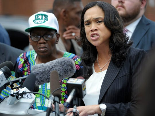 Baltimore State's Attorney Marilyn Mosby, right, holds a news conference in Baltimore in July 2016.