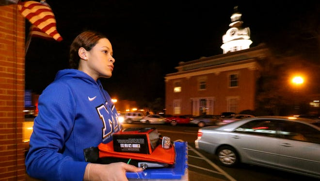 Former MTSU women's basketball player TiAnna Porter carries voting supplies to the Rutherford County Election Commission in this March 2016 photo. MTSU and the election commission have launched the True Blue Voter initiative in order to get students registered to vote and participate in elections.