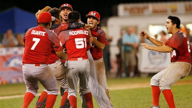 Mexico players celebrate after defeating Hoosier North 6-5 to win the Colt World Series championship Wednesday, August 10, 2016, at Loeb Stadium.