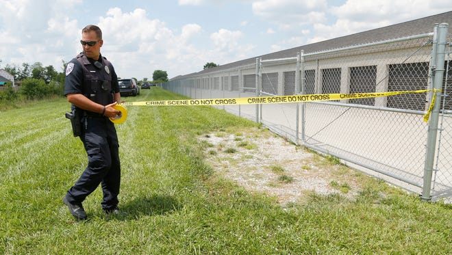 Lafayette Police Department Officer Justin Hartman tapes off a possible crime scene Monday, July 31, 2017, behind Promenade Self Storage, 3700 Promenade Parkway on the south side of Lafayette.