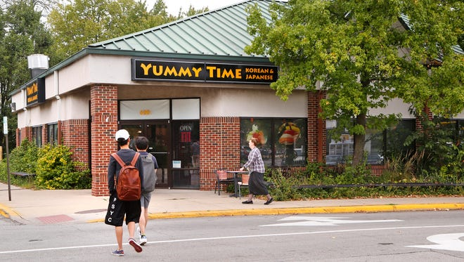 Yummy Time restaurant will share a building with a Domino's franchise at 616 Stadium Ave. in West Lafayette. The building had been the site of a redevelopment plan that the owner now says has been abandoned.