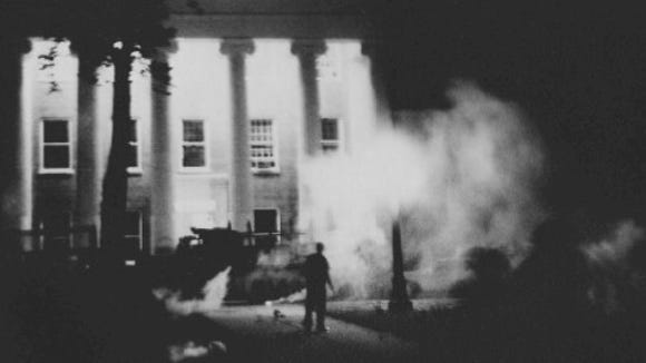 U.S. marshals use tear gas to protect the lyceum on the University of Mississippi campus on the evening of Sept. 30, 1962. Two were killed in the violence that ensued that night after the admission of James Meredith, the first known black student to be admitted.