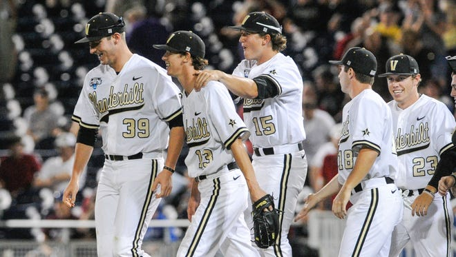 Vanderbilt pitchers Walker Buehler (13) and Carson Fulmer (15) are joined by Philip Pfeifer (not pictured) to make up the weekend rotation.