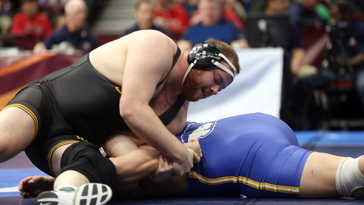 Iowa's Sam Stoll turns Hofstra's Mike Hughes as they