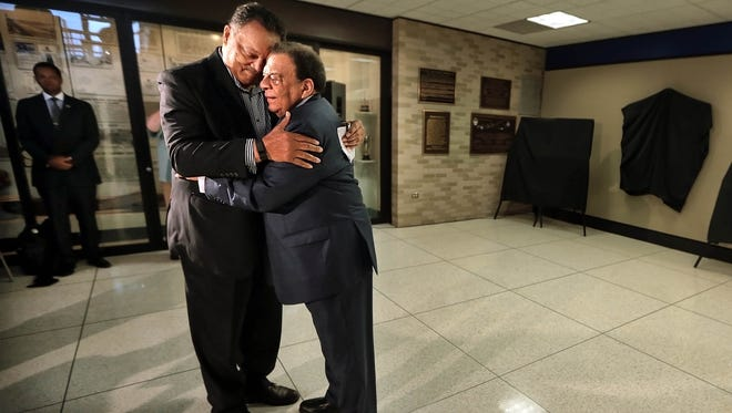 Civil rights activist Jesse Jackson and former U.N. Ambassador Andrew Young embrace during a ceremony at the Memphis International Airport to unveil a historical marker commemorating the final flight of Dr. Martin Luther King Jr. Jackson and Young were members of King's inner circle during the civil rights movement.