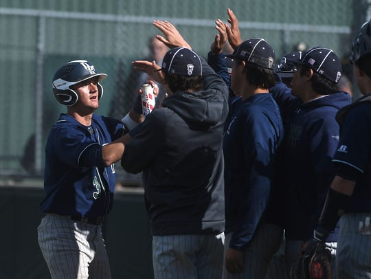 Damonte Ranch's Jerry Thomas (3) greets his teammates