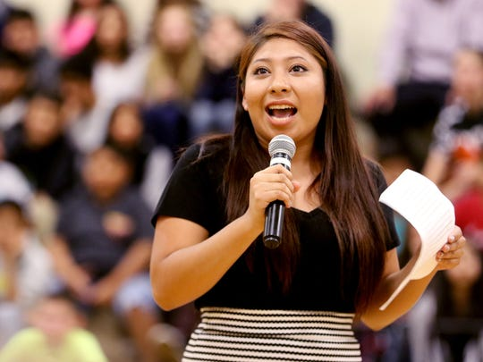 Elizabeth Quirino, a senior at McKay High School, speaks about her six years in the AVID program during an assembly announcing the start of an effort to earn the status of an AVID National Demonstration School at Stephens Middle School in Salem on Wednesday, Oct. 14, 2015.