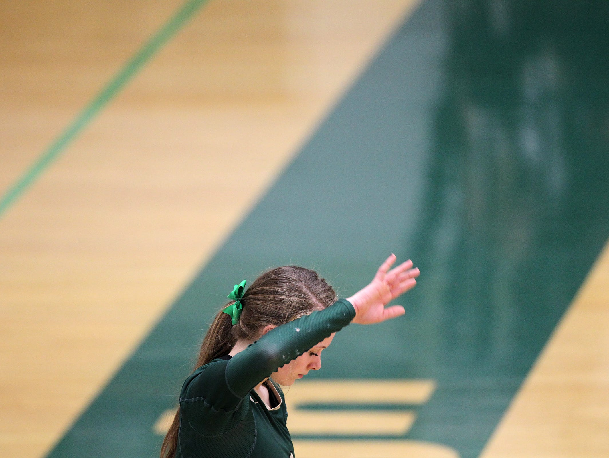 West High's Madi Ford prepares to serve during the Women of Troy's regional semifinal game against City High at West High on Thursday, Oct. 29, 2015.