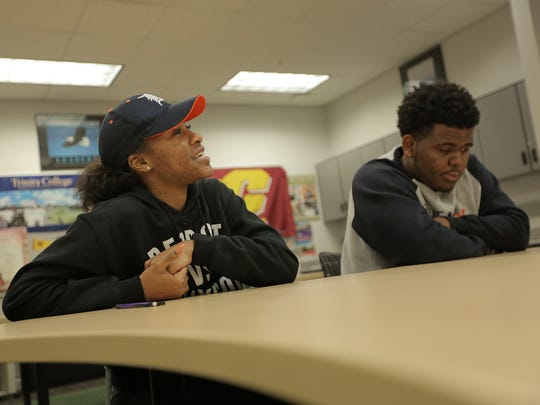 Le'Elle Davis, 16, a senior a Cass Tech High School in Detroit, wishes others could see what she sees. She's with 17-year-old Chance Carson of Detroit.
