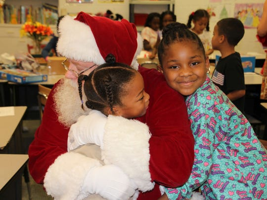 All of the children at the Gifford Youth Achievement Center love Santa and gave him big hugs when he came to visit.