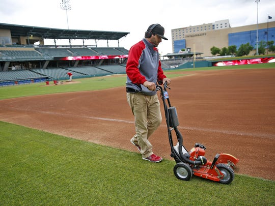 Victory Field Head Groundskeeper Joey Stevenson edges the grass around the field at Victory Field, Monday, May 1, 2017.  The next game at the Indianapolis Indians home field is Tuesday, May 2, 2017.