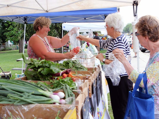 Farmers markets, like the Burlington Farmers Market, provide access to fresh healthy food in communities. Larry Ville Gardens (pictured) provides certified natrually grown produce.