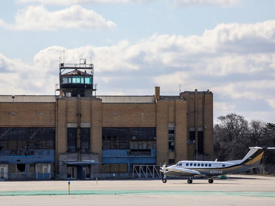 An Air Eagle turbo prop taxies to the hangar in the