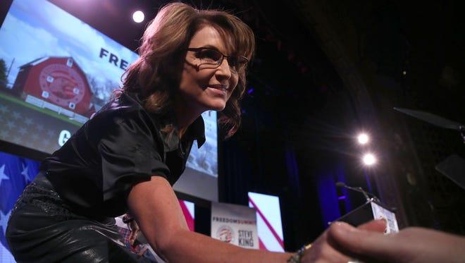 Sarah Palin reaches out to shake the hand of a supporter during the Iowa Freedom Summit on Saturday in Des Moines.