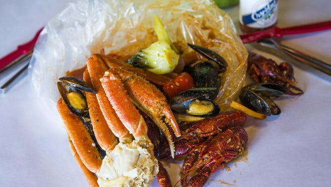 Monday mixed bag (snow crab, sausage, vegetables, crawfish, muscles) from the Angry Crab restaurant in Mesa January 6, 2015.